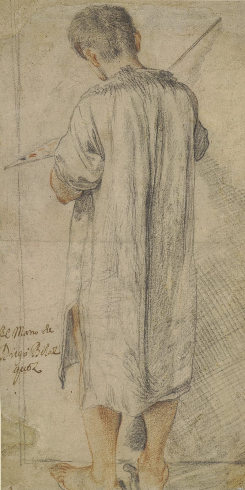 Attributed to Annibale Carracci, A young painter, seen from behind; whole-length standing, holding a palette and brush, wearing a smock, c. 1575-1609, Black and red chalk, 37.8 x 18.8 cm © Trustees of the British Museum
